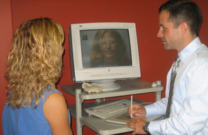 Dr. Andrew Denton performing a plastic surgery consultation