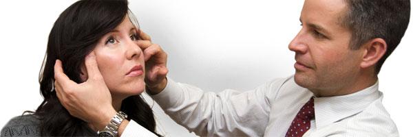 Dr. Denton examining a patient
